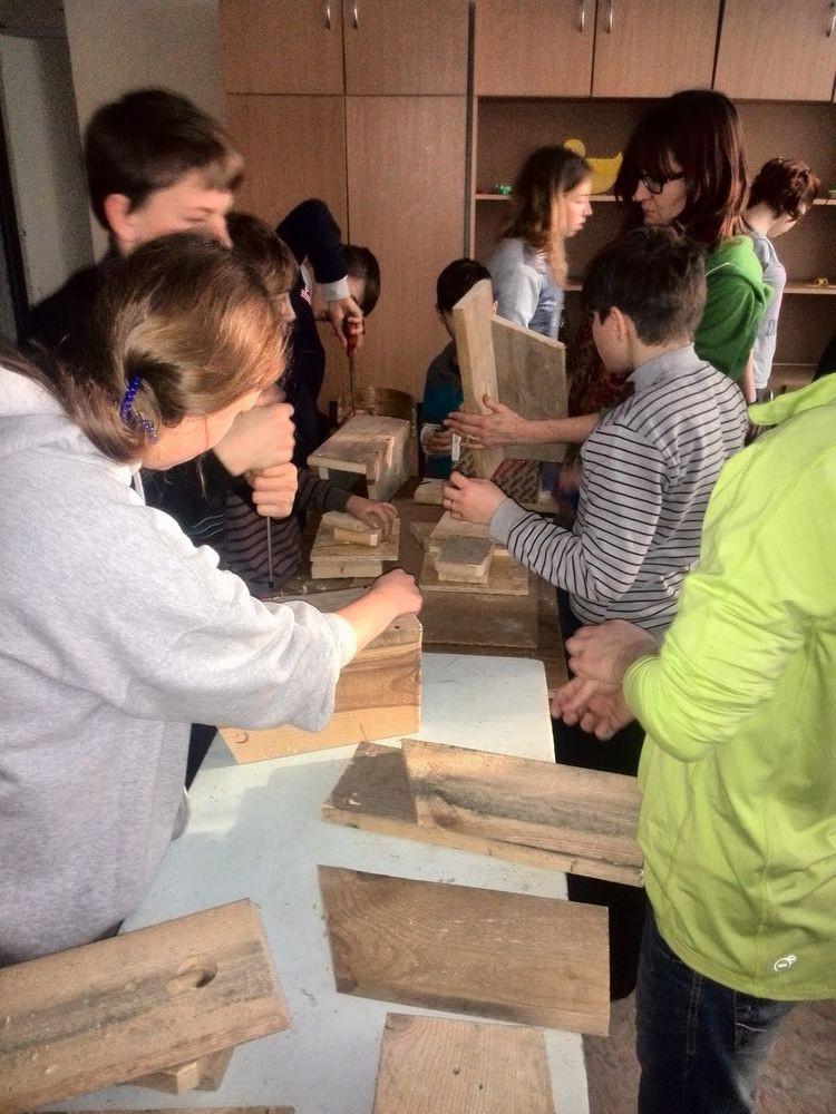 omers and volunteers build bird boxes with orphans as instructed by heyden evans