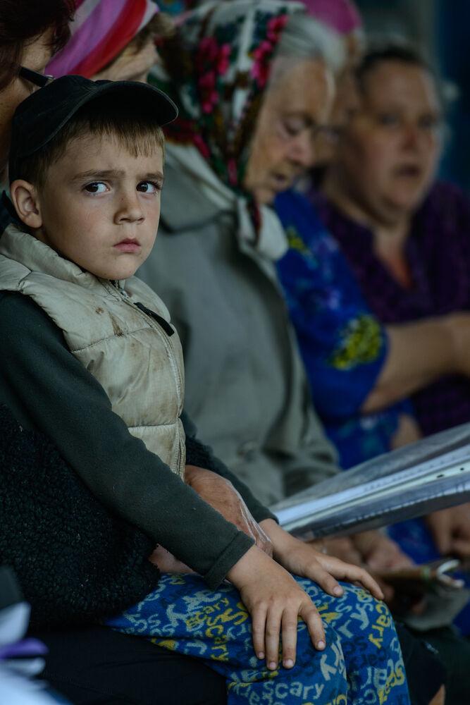 young boy in church service - photo by garrett n