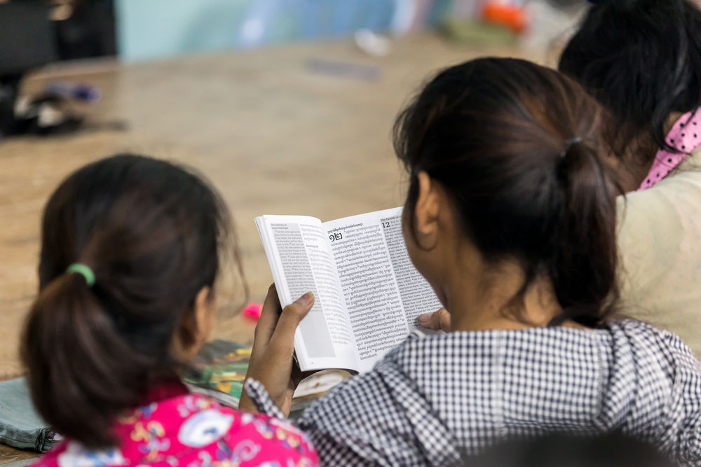 Employees at the VillageWorks factory in Cambodia spend two afternoons a week learning English through God's Word. Photography by Adrian Green