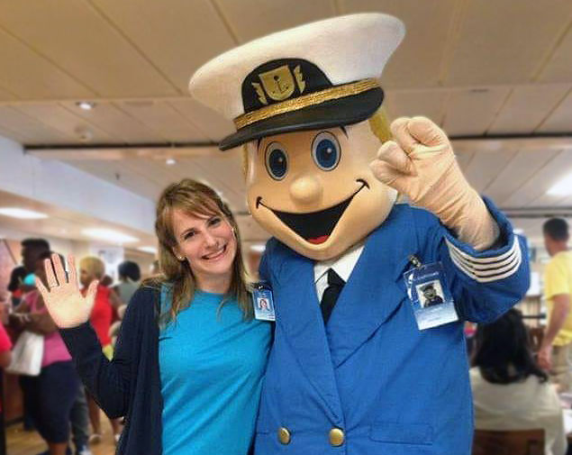 Tünde Ujlaki (Hungary) smiles with El Capitano, the Logos Hope mascot, onboard the ship. Tünde served in the catering department on Logos Hope in 2017.